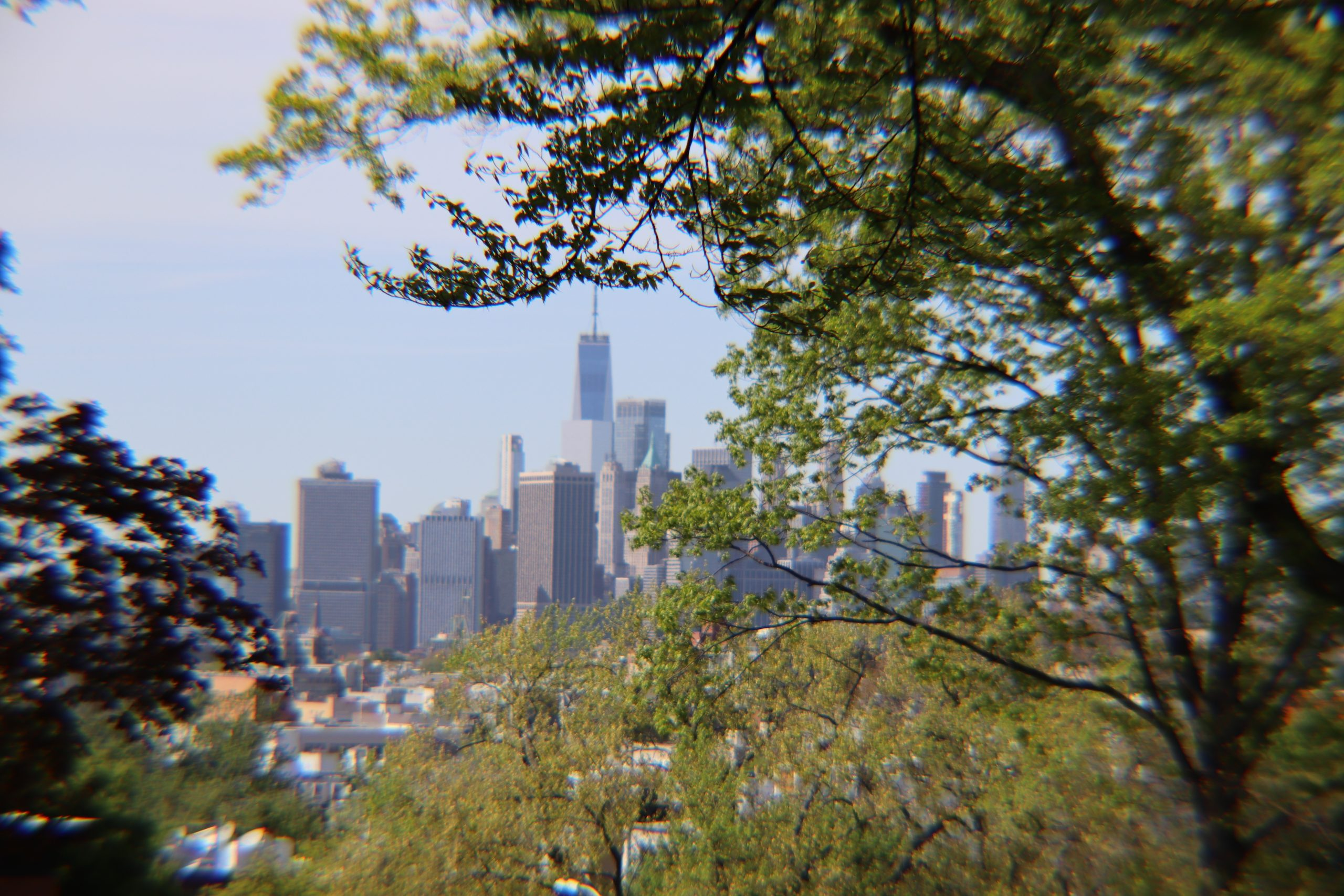 View of Manhattan from Green-Wood Cemetery using a 55MM lens length with a 2x telephoto adapter. You can see how the sides are blurry. I didn't feel the magnification was worth it.