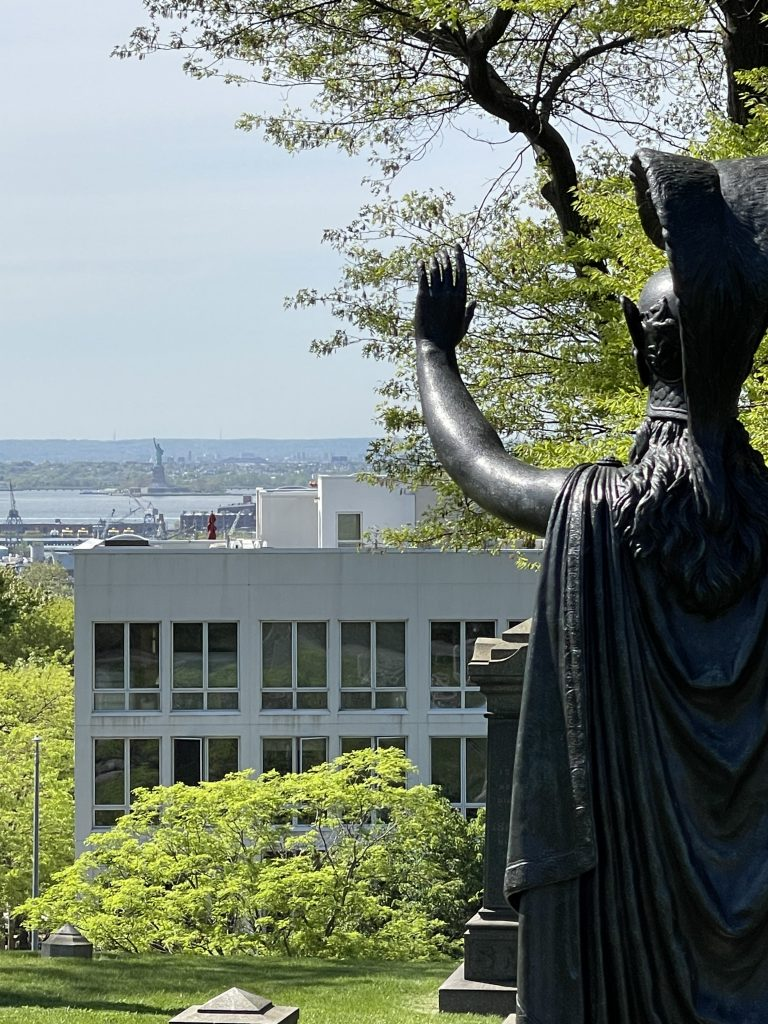 Statue of Minerva waiving to Lady Liberty Across the Upper Bay