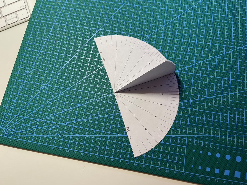 My paper sundial from a customized printout -- cut and folded, ready to use. Source - Printable Popup Sundials